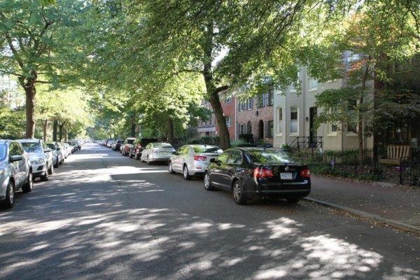 Residential street with homes and parked cars