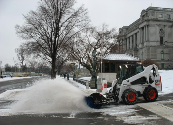 Snow being cleared at the Library of Congress (Flickr pool photo by OZinOH)