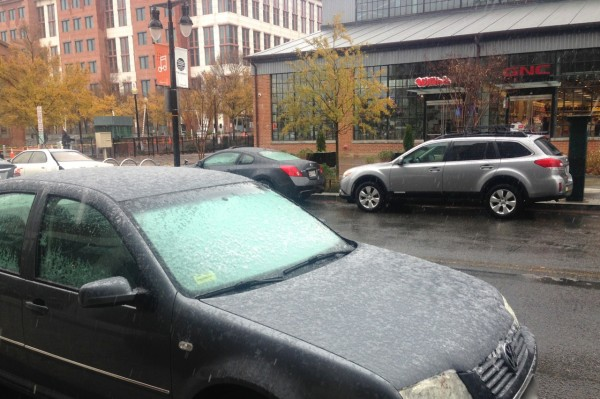 Snow stuck to windshields on Tingey Street SE near 3rd Street SE late Wednesday morning