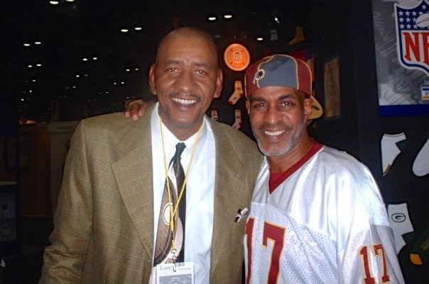 """NBA great George """"The Iceman"""" Gervin and store owner Rodney Smith (Photo via Facebook/Capitol Hill Sporting Goods)"""