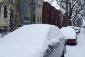 Snow covered cars parked on the Hill (Photo by Jessica Estepa)