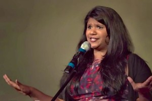 Vijai Nathan telling a story at SpeakeasyDC event (Photo via Vimeo/SpeakeasyDC)
