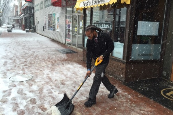 Ted's Bulletin supervisor Born Lancaster shovels snow outside the Barracks Row restaurant.