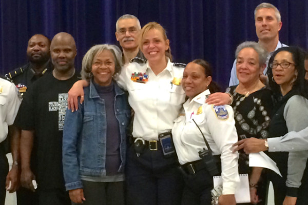 Police Chief Cathy Lanier posed for a photo with locals at a First District Citizens Advisory Council meeting
