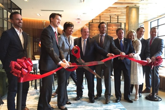 Mayor Muriel Bowser cuts the ribbon to officially open Station House