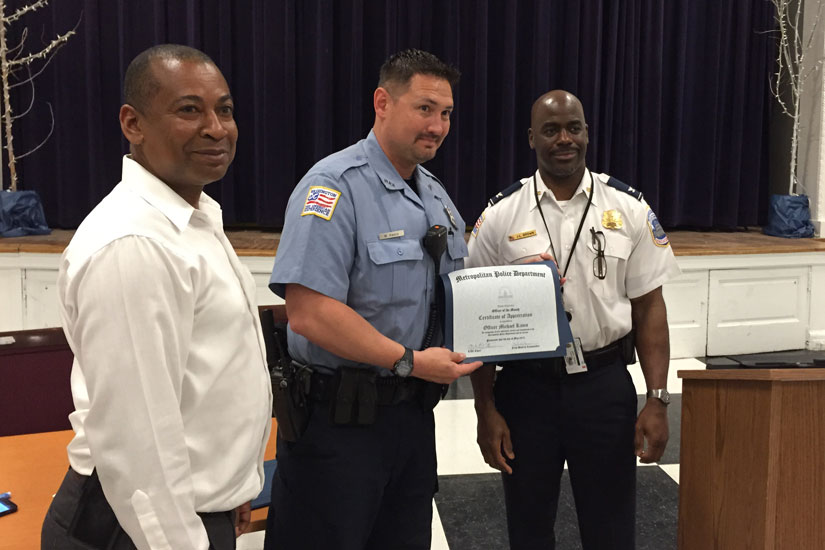 "Officer Michael Kasco receives the ""Officer of the Month"" award"