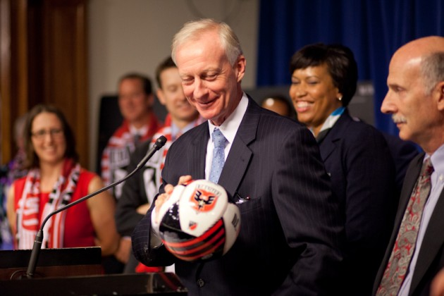 Councilman Jack Evans of Ward 2 jokes that he can still palm a soccer ball, despite his age.