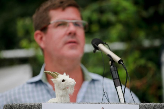 A small goat figure adorned  a podium.