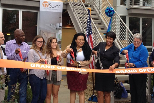 Mayor Muriel Bowser helps cut the ribbon for 17 Solar.