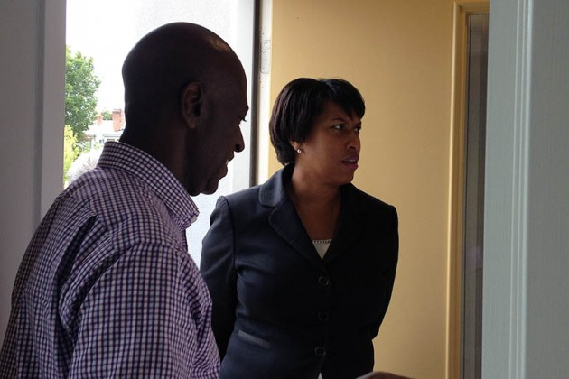 Mayor Muriel Bowser talks to developer Phinis Jones at 17 Solar.