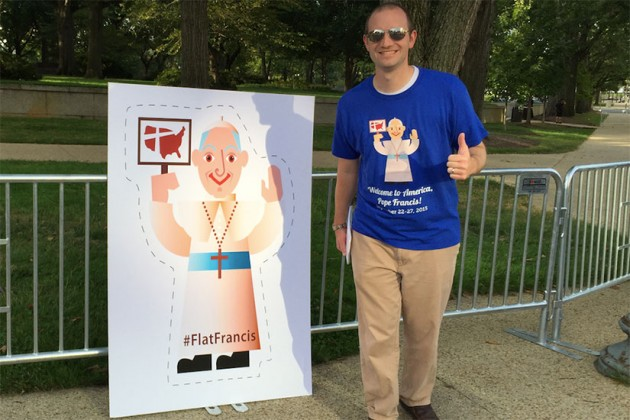 "Matt Paolelli of the Catholic Church Extension Society poses with ""Flat Francis."""
