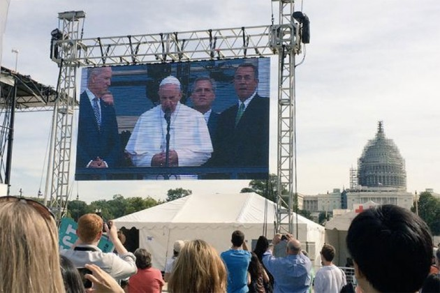 Crowds watch Pope Francis outside the U.S. Capitol. (Photo via Twitter/DC Archdiocese)