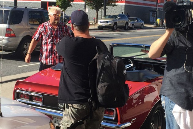 "Guy Fieri is filmed by the ""Diners, Drive-Ins and Dives"" in front of Toki Underground"