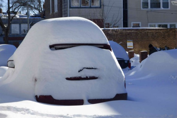 Snow covered car in Capitol Hill (Photo courtesy of Cynthia Wei)