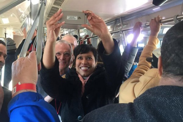 Mayor Muriel Bowser rides the streetcar (Photo via Twitter/Mayor Muriel Bowser)